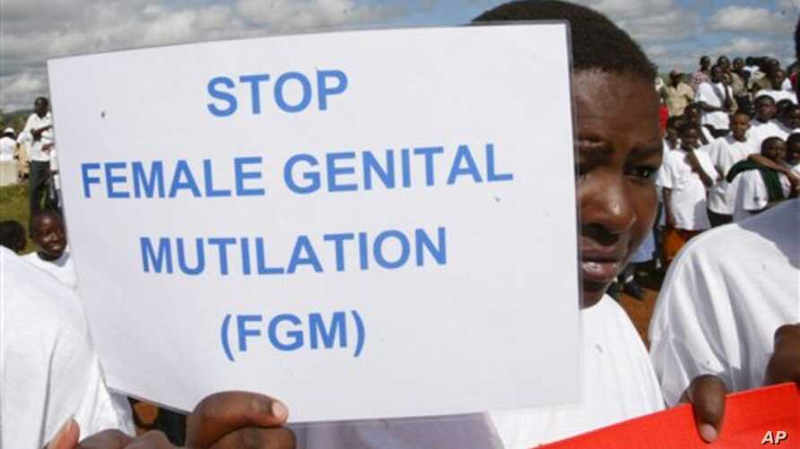 ** ADVANCE FOR FRIDAY, MAY 25 ** A Masai girl holds a protest sign during the anti-Female Genital Mutilation (FGM) run in Kilgoris, Kenya, April 21, 2007. At least 2 million girls every year are at a risk of undergoing FGM. The cut, which is generally done without anesthesia may have lifelong health consequences. (AP Photo/Sayyid Azim)