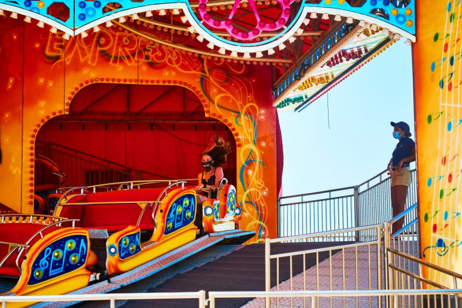 A lone rider on the Musik Express attraction in Seaside Heights, N.J., on July 2, 2020.